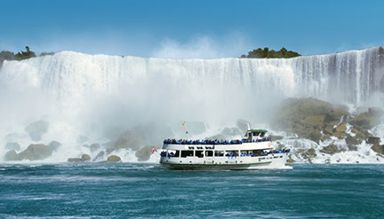 Image of the Maid of the Mist at the foot of Niagara Falls.